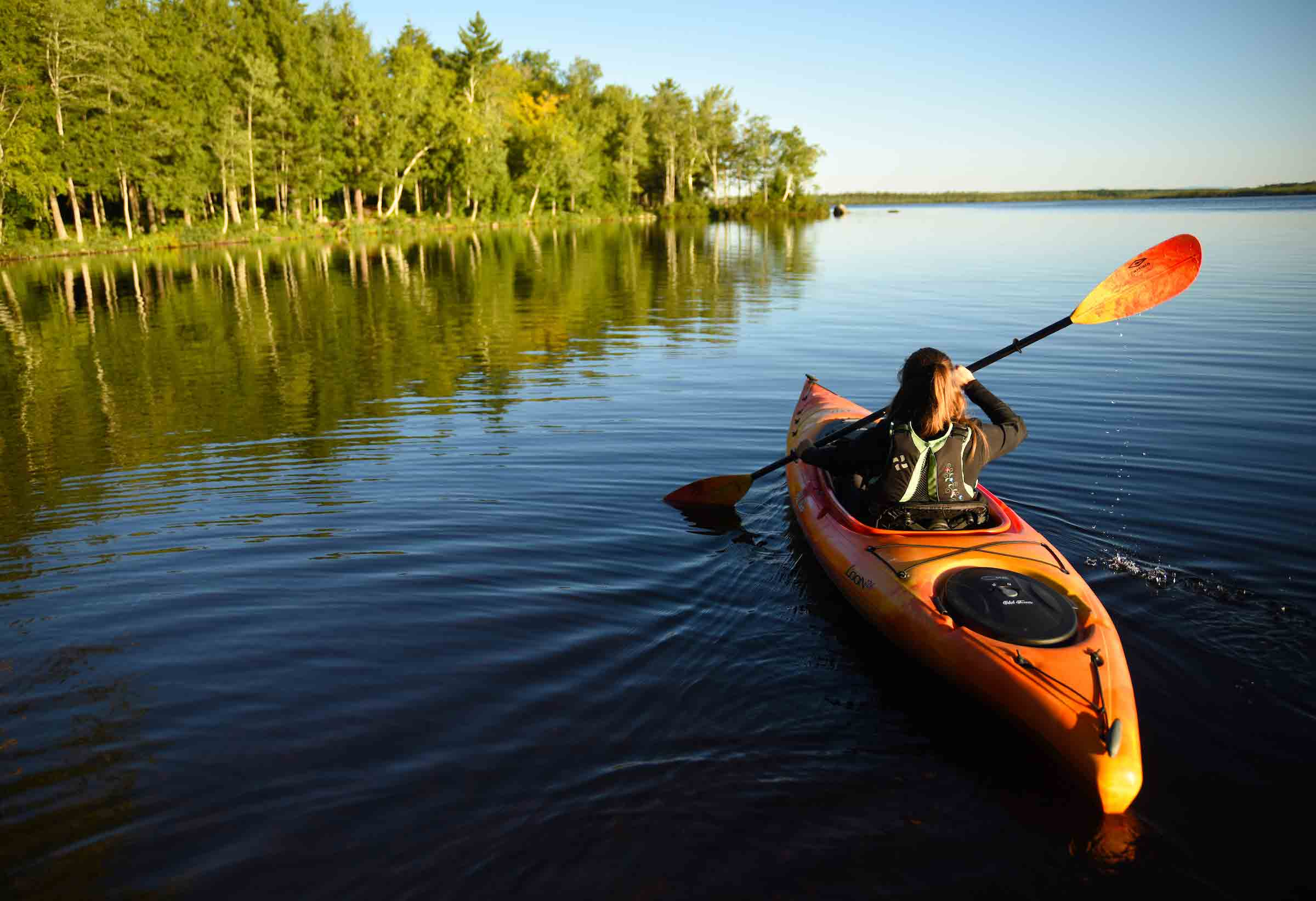 person kayaking in the summer